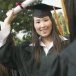 Stock Photo: Graduate Holding Diploma