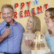 Man giving speech at retirement party — Stock Photo #33799889
