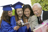 Family Videotaping Graduation — Stock Photo
