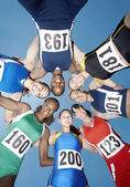 Athletics smiling in a circle — Stock Photo