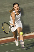 Tennis Player Reaching to hit tennis ball — Stock Photo