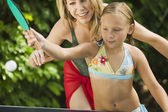 Girl Playing Ping-Pong with Mother. — Stock Photo