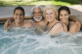 Family in hot tub — Stock Photo