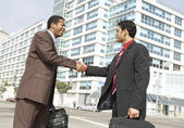 Business men shaking hands — Stock Photo