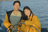 Couple at Helm of Boat — Stock Photo