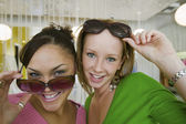 Girls Trying on Sunglasses — Stock Photo