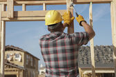 Construction worker working on timber frame — Photo