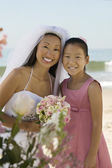Bride and sister on beach — Stock Photo