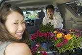Couple Loading flowers — Stock Photo
