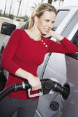 Woman refueling her car at the gas station — Stock Photo