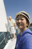 Woman smiling on sailboat — Stock Photo