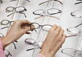 Hands pulling glasses — Stock Photo