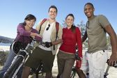 Friends st with mountain bikes — Stock Photo
