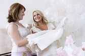 Bride Showing Off Dress at Bridal Shower — Stock Photo