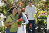 Woman with mother in plant nursery — Stock Photo