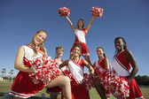 Cheerleading squad in formation — Stock Photo
