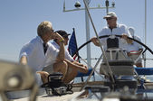 Sailors talking at Helm on Yacht — Stock Photo