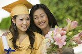 Graduate and mother — Stock Photo