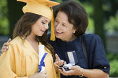 Graduate Receiving Gift from Grandmother — Stock Photo