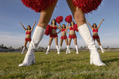 Cheerleaders with pom poms — Stock Photo