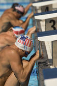 Swimmers Lined Up at Starting Blocks — Stok fotoğraf