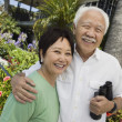 Smiling Couple with Binoculars — Stock Photo