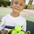 Boy Holding Tennis Trophy — Stock Photo #33800305