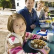 Picnic table with family — Stock Photo