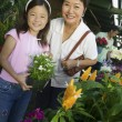 Grandmother and granddaughter in plant nursery — Foto Stock