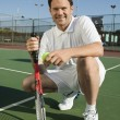 Man crouching on Tennis Court — Stok fotoğraf