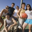 Group of young adults at basketball court. — Stockfoto