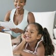 Stock Photo: Mother and Daughter Looking at Laptop