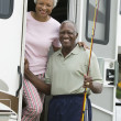 Senior couple on steps of caravan — Stock Photo #33800707