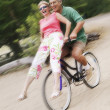 Woman riding on handlebars  — Stockfoto