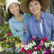 Mother and daughter in garden — Stock Photo #33800803