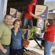 Couple unloading moving boxes — Stock Photo #33801163