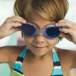 Stock Photo: Girl adjusting goggles