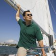 Man on sailboat — Foto de Stock