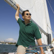 Man on sailboat — Stock Photo