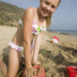 Girl Playing in Sand at Beach — Stock Photo
