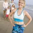 Woman on beach with family — Stockfoto