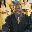 Minister  with Bible amd gospel choir — Foto de Stock
