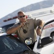 Police officer using two way radio — Stock Photo #33801381