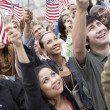 People holding up American flags — Stock Photo