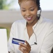 Woman Using Credit Card Online — Stock Photo #33801675