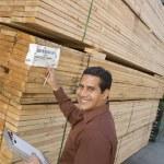 Supervisor checking label — Stock Photo