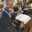 Stock Photo: Preacher at altar