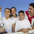 Tennis Family  holding trophy — Stock Photo