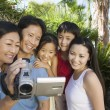 Asian Family Looking at Video Camera — Stock Photo