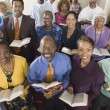 Church congregation sitting on church — Stock Photo #33802021